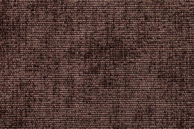 Темно-коричневый фон из мягкого текстильного материала. ткань с натуральной текстурой.