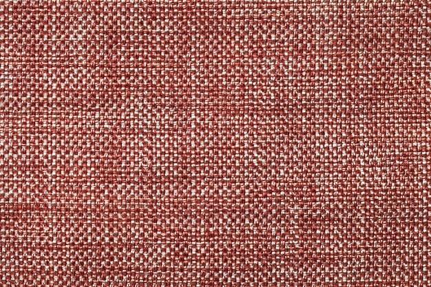 濃い赤の繊維の背景、クローズアップ。ファブリックマクロの構造。
