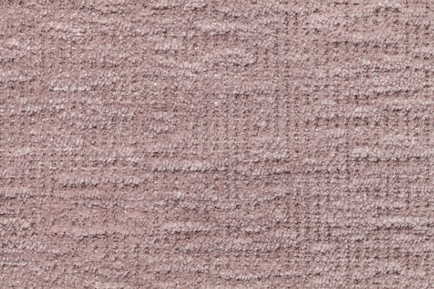 柔らかく、フリースの布の明るい茶色のふわふわの背景。豪華な毛皮のような織物、クローズアップのテクスチャ。