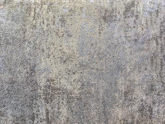 灰色茶色の大まかな斑状プラスターの形で抽象的な背景の構造。