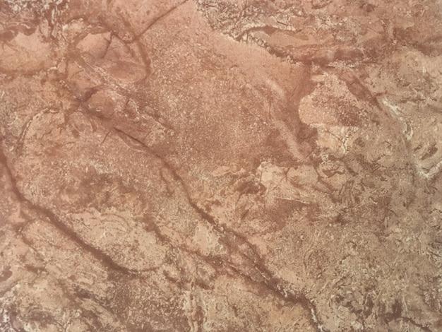 Мраморная коричневая предпосылка от керамической плитки, крупного плана.