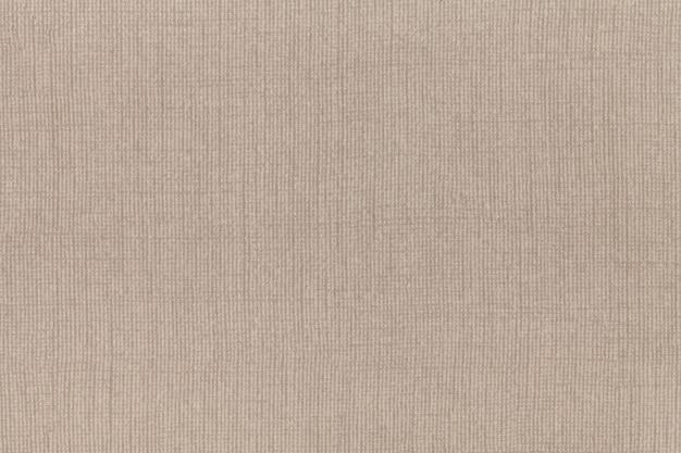 繊維素材から明るいベージュの背景。自然な風合いの生地。