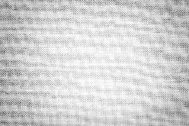 繊維材料からの明るい灰色の背景。自然な風合いの生地。
