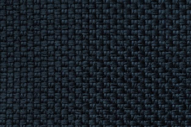 市松模様、クローズアップで暗い青色の背景。ファブリックマクロの構造。
