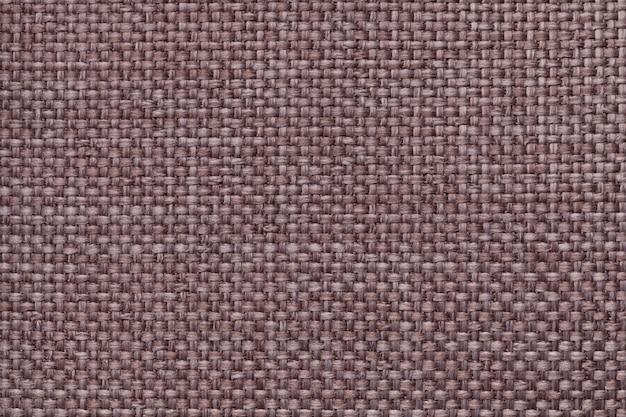 Коричневый фон с плетеной клетчатым узором, крупным планом. текстура плетения ткани, макро.