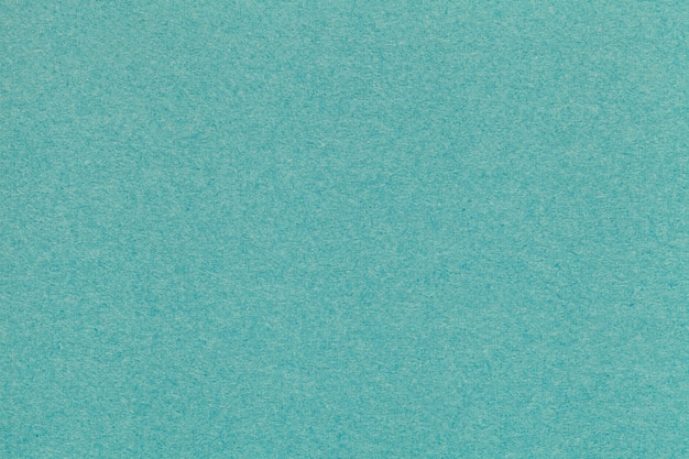 Текстура старого крупного плана бирюзовой бумаги. структура плотного картона. зеленый фон.