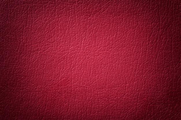 濃い赤革のテクスチャ背景。