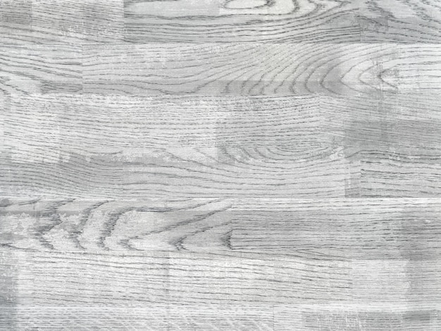 Светло-серый потертый винтажный ламинат.