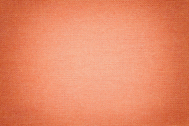 Светлый коралловый фон из текстильного материала.