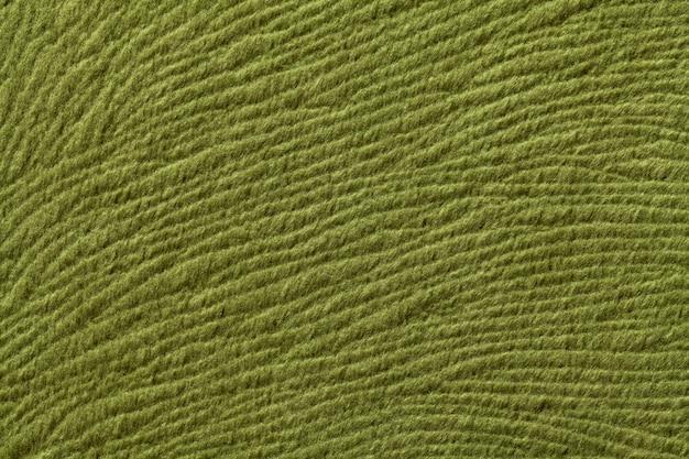 柔らかい繊維材料、自然な風合いの生地からグリーンオリーブの背景、