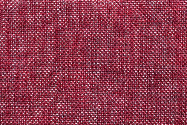 Темно красная текстильная фон с клетчатым узором, крупным планом.