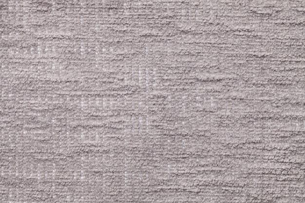 柔らかい、フリースの布の明るい灰色のふわふわの背景。
