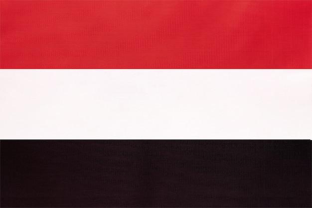イエメンの国旗、繊維の背景。国際的なアジア世界の国の象徴