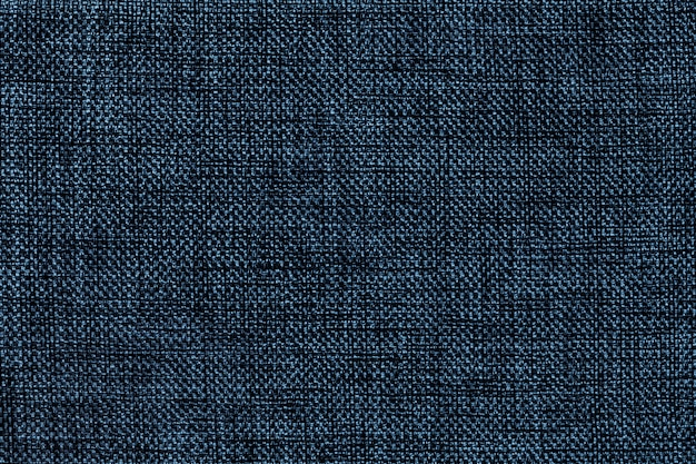 密な織りバギング生地、クローズアップのネイビーブルーの背景。テキスタイルマクロの構造。