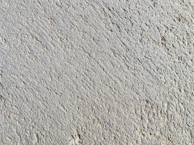 灰色の古代の石、背景のテクスチャ