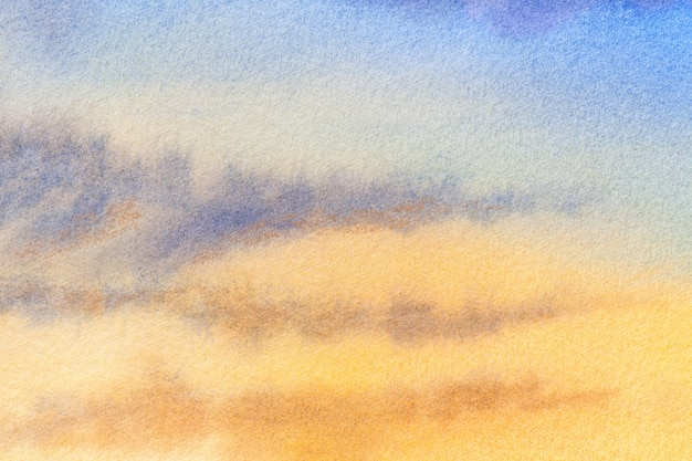 抽象芸術の背景の明るい青と黄色の色。汚れとキャンバスの水彩画。