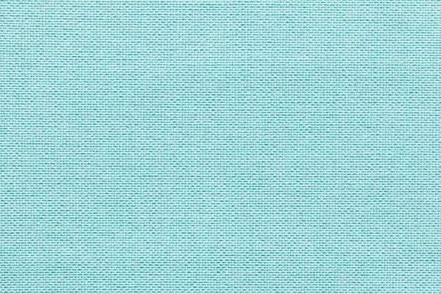 Светло голубой фон из текстильного материала с плетеной узором, крупным планом.