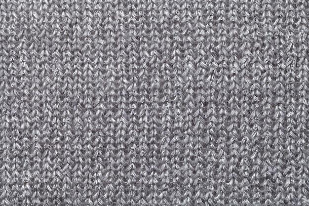 灰色の繊維の背景のクローズアップ、ファブリックマクロの構造