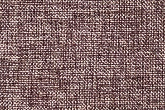 Коричневый и белый текстильный фон крупным планом, структура ткани макроса