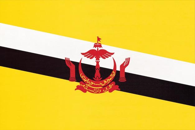 Брунейский национальный флаг ткани текстильной фона, символ мира азиатской страны,