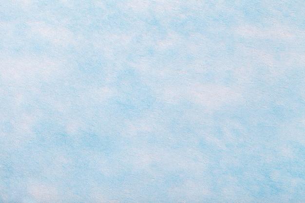 フェルト生地の明るい青の背景。