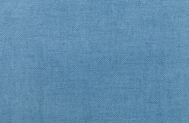 繊維材料からの明るい青の背景