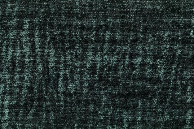 Темно-зеленый пушистый фон из мягкой, ворсистой ткани, текстура плюшевого пушистого текстиля,