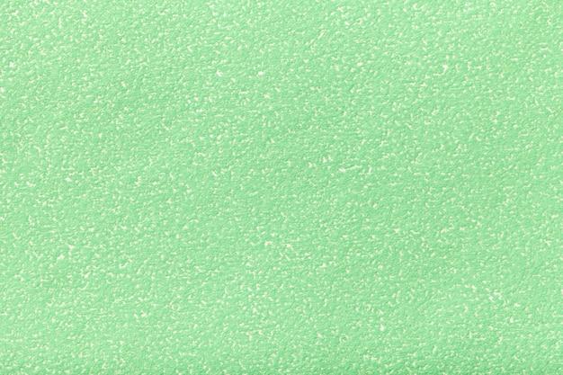 古い薄緑色の紙のテクスチャ密な段ボール、オリーブの背景の構造