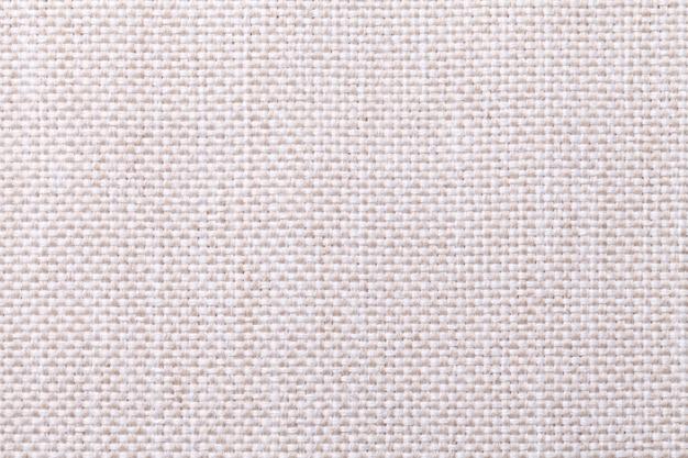 Белая и бежевая текстильная фон с клетчатым узором, крупным планом. структура ткани макроса.