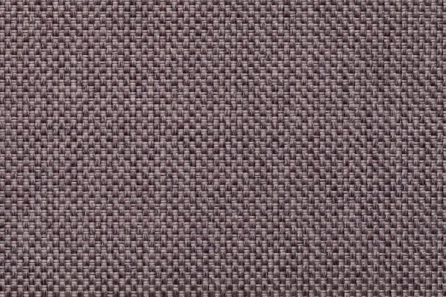 Темно коричневый текстильной фона крупным планом. структура ткани макроса