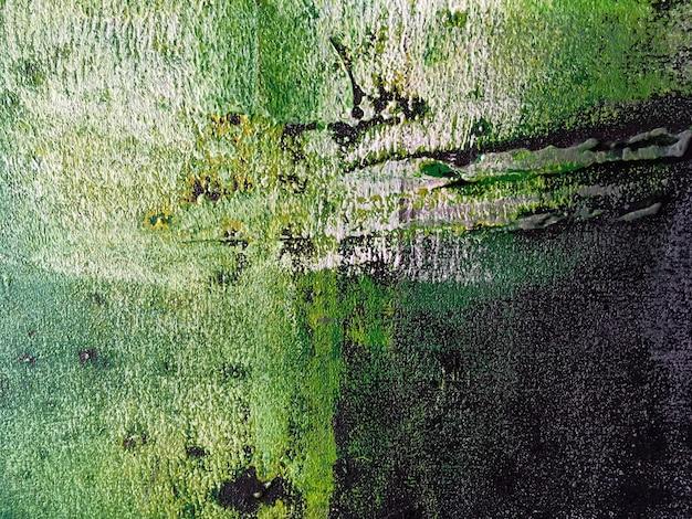 抽象芸術の背景に緑と黒の色。