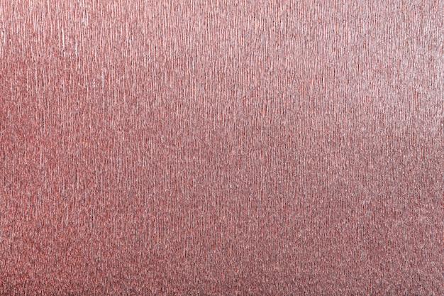 波状の段ボール紙、クローズアップの赤い背景のテクスチャ。