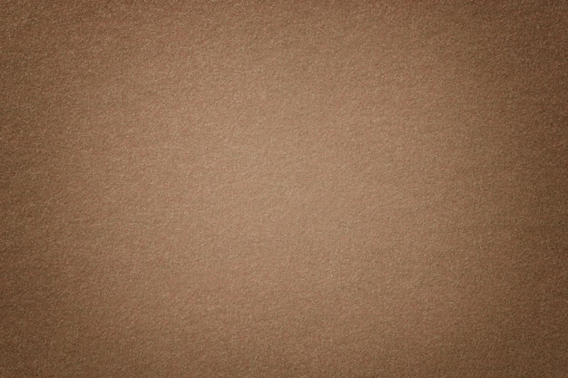 Светло коричневый матовый замша ткань крупным планом. бархатная текстура из фетра.