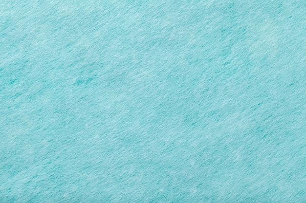 ライトブルーのマットスエード生地のクローズアップ。フェルトのベルベットの質感。