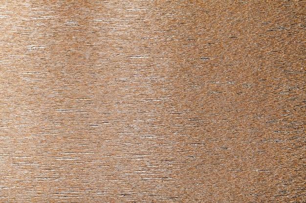波状段ボール紙の青銅色の背景のテクスチャ
