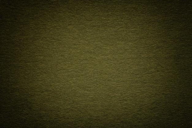 Текстура старой темной предпосылки зеленой бумаги, крупного плана. структура плотного глубокого голубоватого картона.