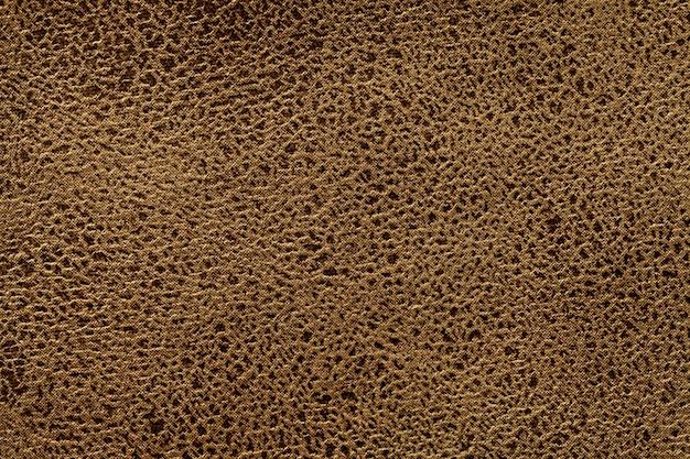 柔らかい家具製造販売業の繊維材料からの茶色の背景、
