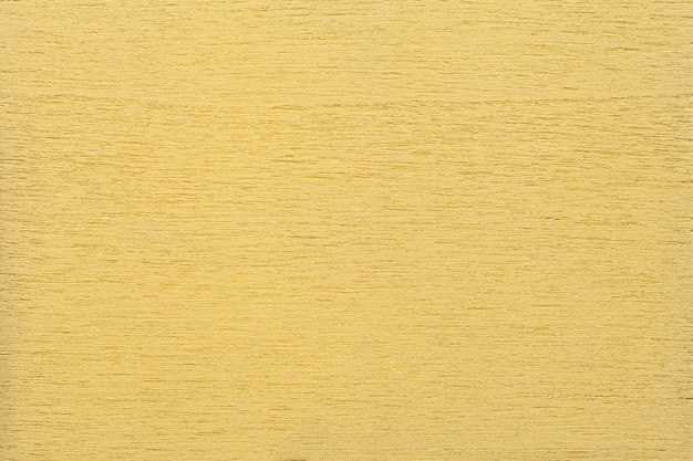 明るい黄色のきれいな木質背景、クローズアップの塗装木材の構造