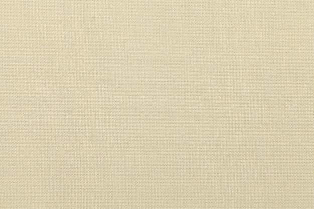 Светло-бежевый фон из текстильного материала. ткань с натуральной текстурой.