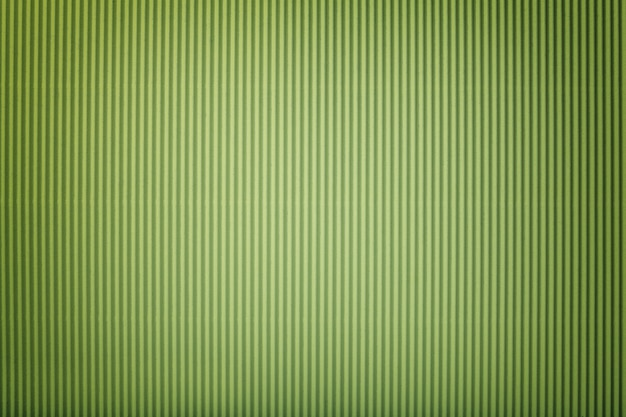 ビネットと波状の薄緑色の紙のテクスチャ、マクロ。