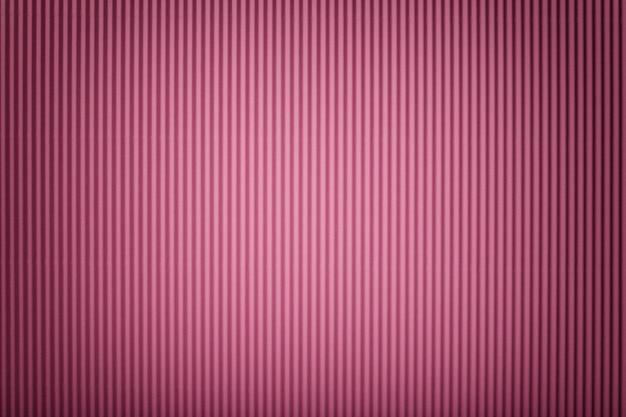 背景、ビネットと段ボールのピンクの紙のテクスチャ。