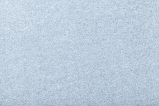 ライトブルーのマットスエード生地のクローズアップ。フェルトバックグラウンドのベルベットのテクスチャ