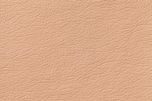 Светло-оранжевая кожа текстура фон с рисунком, крупным планом
