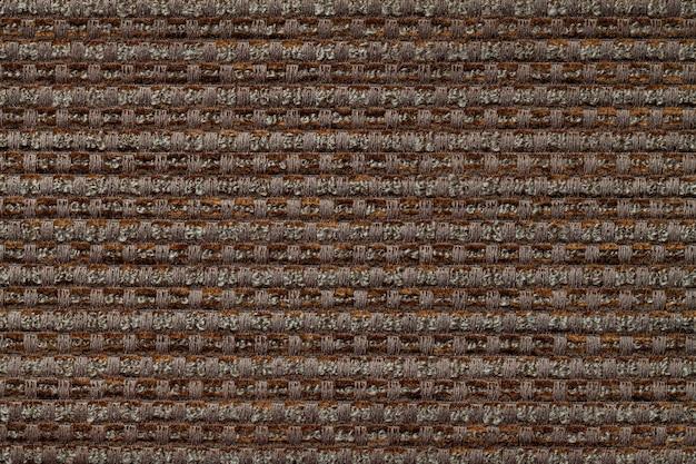 Темно коричневый фон из клетчатого узора ткани, крупным планом. структура плетеной ткани макроса.