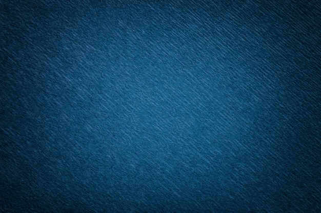 波状の段ボール紙、クローズアップのネイビーブルーの背景のテクスチャ。