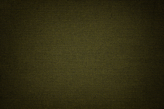 繊維材料からの濃い緑色の背景。自然な風合いの生地。背景。