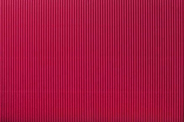 段ボールの濃い赤の紙のテクスチャ、マクロ。