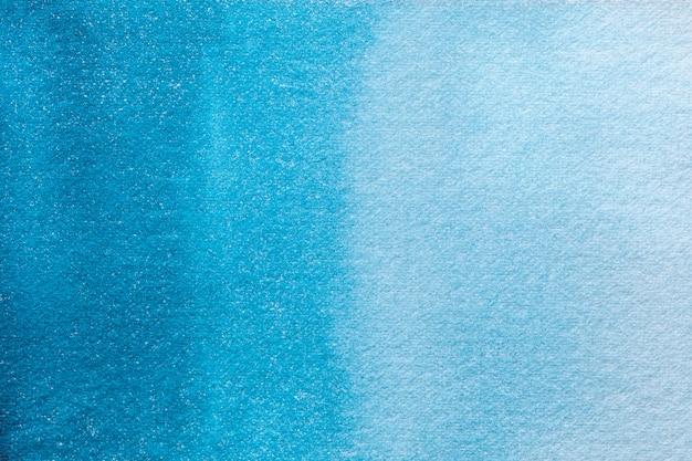 Абстрактное искусство фон светло-бирюзовый и темно-синий цвета. акварельная живопись на холсте.