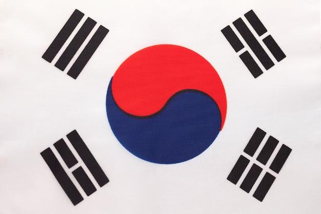韓国の国旗、テキスタイル背景。国際的なアジア世界の国の象徴。