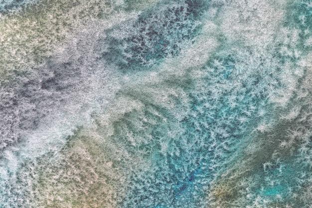 抽象芸術の背景の青緑色と緑色。キャンバスに水彩画。